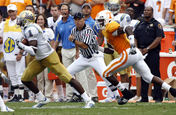 Alterraun Verner #1 of the UCLA Bruins runs after an interception against Denarius Moore #6 of the Tennessee Volunteers on September 12, 2009 at Neyland Stadium in Knoxville, Tennessee.