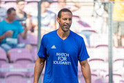 Rio Ferdinand warms up before the UEFA Match for Solidarity at Stade de Geneva on April 21, 2018 in Geneva, Switzerland.