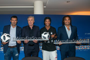 From left Luis Figo, Former Portuguese and Real Madrid player, Head Coach Carlo Ancelotti, Ronaldinho, Former Brazil and Barcelona player and Christian Karembeu poses with the sign and match balls during the Press Conference of Match for Solidarity on April 20, 2018 at Grand Hotel Kempinski in Geneva, Switzerland.