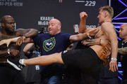 UFC President Dana White (C) gets in between Derrick Lewis (L) and Alexander Volkov as they get into a scuffle during a ceremonial weigh-in for UFC 229 at T-Mobile Arena on October 05, 2018 in Las Vegas, Nevada. Lewis and Volkov will meet in a heavyweight bout at UFC 229 on October 6 at T-Mobile Arena in Las Vegas.