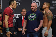 UFC President Dana White (C) looks on as Tony Ferguson (L) and Anthony Pettis (R) face off during a ceremonial weigh-in for UFC 229 at T-Mobile Arena on October 05, 2018 in Las Vegas, Nevada. Ferguson and Pettis will meet in a lightweight bout at UFC 229 on October 6 at T-Mobile Arena in Las Vegas.