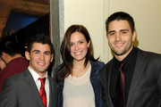 (L-R) Mixed martial arts fighter Dominick Cruz, actress Mandy Moore and mixed martial arts fighter Carlos Condit attend UFC on Fox:  Live Heavyweight Championship at the Honda Center on November 12, 2011 in Anaheim, California.