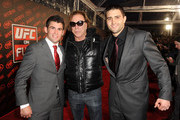 (L-R) Mixed martial arts fighter Dominick Cruz, actor Mickey Rourke and mixed martial arts fighter Carlos Condit attend UFC on Fox:  Live Heavyweight Championship at the Honda Center on November 12, 2011 in Anaheim, California.