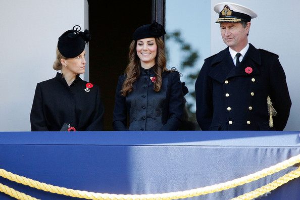 Catherine, Duchess of Cambridge smiles from a balcony, accompanied by Sophie, Countess of Wessex (L) as they watch a wreath laying ceremony at the Cenotaph on Whitehall on November 10, 2013 in London, United Kingdom. People across the UK gathered to pay tribute to service personnel who have died in the two World Wars and subsequent conflicts, as part of the annual Remembrance Sunday ceremonies.