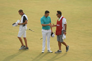 Justin Rose of England shakes hands with caddie Mark Fulcher on the 18th green during the third round of the 2018 U.S. Open at Shinnecock Hills Golf Club on June 16, 2018 in Southampton, New York.
