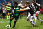 Jeremie Boga of US Sassuolo competes for the ball with Aaron Ramsey of Juventus FC during the Serie A match between US Sassuolo and Juventus at Mapei Stadium - Citta del Tricolore on July 15, 2020 in Reggio nell'Emilia, Italy.
