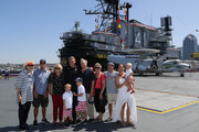 Jesse Smith of Team USA poses for a group photo with his family during the USA Men's Olympic Water Polo Team announcement onboard the USS Midway on July 7, 2016 in San Diego, California.