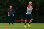 Head coach Jürgen Klinsmann of the United States looks on as Michael Bradley works out during their training session at Sao Paulo FC on June 10, 2014 in Sao Paulo, Brazil.