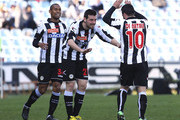 Antonio Di Natale (R) of Udinese Calcio celebrates with his team-mates Andrea Lazzari (C) and Gabriel Moises Antunes Da Silva (L) after scoring his second goal during the Serie A match between Udinese Calcio and AC Chievo Verona at Stadio Friuli on April 7, 2013 in Udine, Italy.