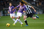 Andrea Lazzari (R) of  Udinese Calcio competes with Juan Quadrado of ACF Fiorentina during the Serie A match between Udinese Calcio and ACF Fiorentina at Stadio Friuli on November 24, 2013 in Udine, Italy.
