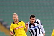 Andrea Lazzari  (R) of Udinese Calcio competes with Alexander Farnerud of  BSC Young Boys during the UEFA Europa League Group A match between Udinese Calcio and BSC Young Boys at Stadio Friuli on November 8, 2012 in Udine, Italy.