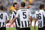 Danilo Larangeira (R) of Udinese celebrates with Andrea Lazzari after scoring his opening goal during the Serie A match between Udinese Calcio and Cagliari Calcio at Stadio Friuli on October 6, 2013 in Udine, Italy.
