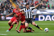 Andrea Lazzari (R) of Udinese is challenged by Davide Astori of Cagliari during the Serie A match between Udinese Calcio and Cagliari Calcio at Stadio Friuli on October 6, 2013 in Udine, Italy.