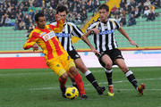 Jeda of Lecce competes with Maurizio Domizzi and Andrea Coda (R) of Udinese during the Serie A match between Udinese and Lecce at Stadio Friuli on November 14, 2010 in Udine, Italy.