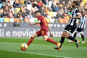 Silvan Widmer (R) of Udinese Calcio competes with Stephan El Shaaraw of AS Roma during the serie A match between Udinese Calcio and AS Roma at Stadio Friuli on February 17, 2018 in Udine, Italy.