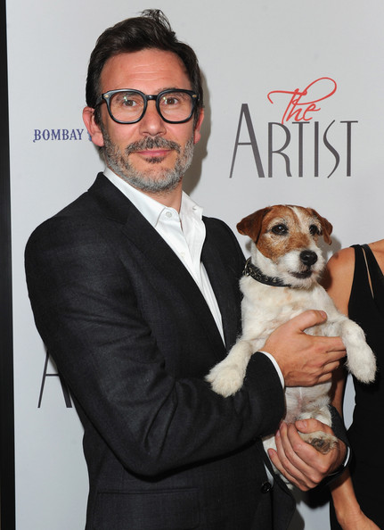 """Uggie Director Michel Hazanavicius and Uggie the dog arrive to a special screening of The Weinstein Company's """"The Artist"""" at AMPAS Samuel Goldwyn Theater on November 21, 2011 in Beverly Hills, California."""