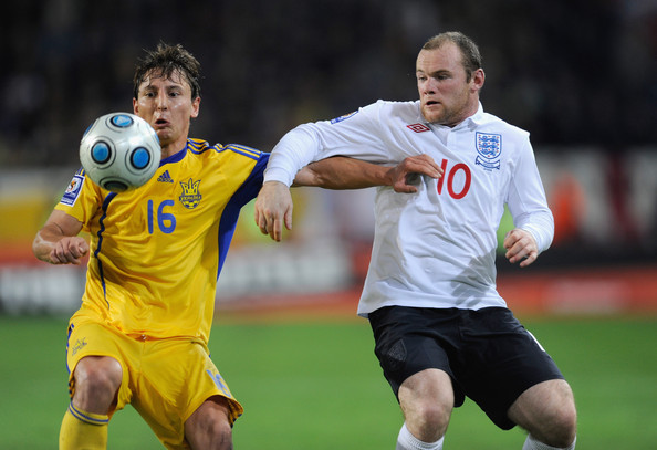 Vasyl Kobin Vasyl Kobin of the Ukraine is challenged by Wayne Rooney of England during the FIFA 2010 World Cup Group 6 Qualifying match between Ukraine and England at the Dnipro Arena on October 10, 2009 in Dnepropetrovsk, Ukraine.