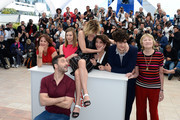 (L-R) Screenwriter Noemie Lvovsky, actress Celine Sallette, actor Filippo Timi, director Valeria Bruni Tedeschi, actor Louis Garrel, actor Xavier Beauvois and actress Marisa Borini attend the 'Un Chateau En Italie' Photocall during The 66th Annual Cannes Film Festival at the Palais des Festivals on May 21, 2013 in Cannes, France.