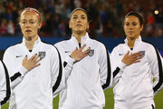 (L-R)  Becky Sauerbrunn #4,  Hope Solo #1 and Carli Lloyd #10 of USA before a match against Costa Rica during the 2016 CONCACAF Women's Olympic Qualifying at Toyota Stadium on February 10, 2016 in Frisco, Texas.