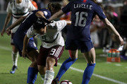 Teammates Rose Lavelle #16 and Tobin Heath #17 of USA go after the ball against Charlene Corral #9 of Mexico during the Group A - CONCACAF Women's Championship at WakeMed Soccer Park on October 4, 2018 in Cary, North Carolina.