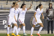 Carli Lloyd #10, Megan Rapinoe #15, Ali Krieger #11 and Christen Press #14 of the United States react after Lloyd scored a goal in the first half against Mexico in the 2014 CONCACAF Women's Championship semifinal game on October 24, 2014 at PPL Park in Chester, Pennsylvania.