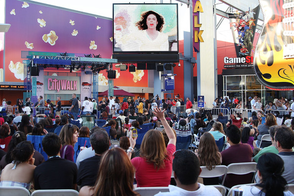 Michael Jackson Fans watch a video of Michael Jackson during the Universal MoonWalk tribute to Michael Jackson at Universal CityWalk on July 9, 2009 in Universal City, California.