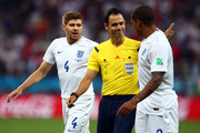 Steven Gerrard of England reacts as referee Carlos Velasco Carballo speaks with Glen Johnson of England during the 2014 FIFA World Cup Brazil Group D match between Uruguay and England at Arena de Sao Paulo on June 19, 2014 in Sao Paulo, Brazil.