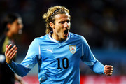 Diego Forlan of Uruguay reacts to a missed chance during the 2010 FIFA World Cup South Africa Third Place Play-off match between Uruguay and Germany at The Nelson Mandela Bay Stadium on July 10, 2010 in Port Elizabeth, South Africa.