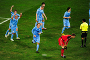 Diego Godin (#3) and Egidio Arevalo (#17) of Uruguay celebrate the goal scored by Diego Forlan (#10) during the 2010 FIFA World Cup South Africa Third Place Play-off match between Uruguay and Germany at The Nelson Mandela Bay Stadium on July 10, 2010 in Port Elizabeth, South Africa.