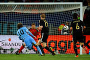 Diego Forlan of Uruguay scores his team's second goal during the 2010 FIFA World Cup South Africa Third Place Play-off match between Uruguay and Germany at The Nelson Mandela Bay Stadium on July 10, 2010 in Port Elizabeth, South Africa.