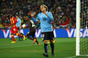Diego Forlan of Uruguay reacts to a missed chance during the 2010 FIFA World Cup South Africa Quarter Final match between Uruguay and Ghana at the Soccer City stadium on July 2, 2010 in Johannesburg, South Africa.