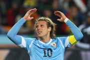 Diego Forlan of Uruguay gestures during the 2010 FIFA World Cup South Africa Quarter Final match between Uruguay and Ghana at the Soccer City stadium on July 2, 2010 in Johannesburg, South Africa.