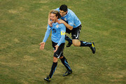 Diego Forlan and Luis Suarez Photos Photo