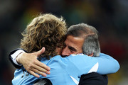 Oscar Tabarez head coach and Diego Forlan of Uruguay celebrate victory after winning a penalty shoot out during the 2010 FIFA World Cup South Africa Quarter Final match between Uruguay and Ghana at the Soccer City stadium on July 2, 2010 in Johannesburg, South Africa.
