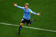 Diego Forlan of Uruguay celebrates scoring his side's first goal during the 2010 FIFA World Cup South Africa Semi Final match between Uruguay and the Netherlands at Green Point Stadium on July 6, 2010 in Cape Town, South Africa.