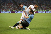 Ricardo Quaresma of Portugal is tackled by Diego Laxalt and Cristian Rodriguez of Uruguay during the 2018 FIFA World Cup Russia Round of 16 match between Uruguay and Portugal at Fisht Stadium on June 30, 2018 in Sochi, Russia.