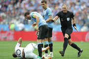 Referee Nestor Pitana stops Diego Godin of Uruguay from arguing with Kylian Mbappe of France during the 2018 FIFA World Cup Russia Quarter Final match between Uruguay and France at Nizhny Novgorod Stadium on July 6, 2018 in Nizhny Novgorod, Russia.