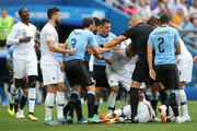 Kylian Mbappe of France lies on the pitch injured while Uruguay and France players argue during the 2018 FIFA World Cup Russia Quarter Final match between Uruguay and France at Nizhny Novgorod Stadium on July 6, 2018 in Nizhny Novgorod, Russia.