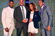 Usher, honoree Shawn Wilson, Malia Murray, and Ludacris attend the 15th Anniversary Celebration of Usher's New Look at the President's Circle Awards Luncheon on July 31, 2014 in Atlanta, Georgia.