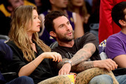 Singer Adam Levine and Behati Prinsloo are seen courtside at Staples Center on April 13, 2016 in Los Angeles, California. NOTE TO USER: User expressly acknowledges and agrees that, by downloading and or using this photograph, User is consenting to the terms and conditions of the Getty Images License Agreement.