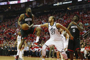 James Harden #13 of the Houston Rockets goes up for a shot defended by Rudy Gobert #27 of the Utah Jazz in the second half during Game Two of the Western Conference Semifinals of the 2018 NBA Playoffs at Toyota Center on May 2, 2018 in Houston, Texas.  NOTE TO USER: User expressly acknowledges and agrees that, by downloading and or using this photograph, User is consenting to the terms and conditions of the Getty Images License Agreement.