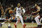 Donovan Mitchell #45 of the Utah Jazz drives to the basket defended by Michael Carter-Williams #1 of the Houston Rockets in the first half at Toyota Center on October 24, 2018 in Houston, Texas.  NOTE TO USER: User expressly acknowledges and agrees that, by downloading and or using this Photograph, user is consenting to the terms and conditions of the Getty Images License Agreement.