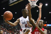 D.J. Gay #23 of San Diego State looks to pass the ball against Josh Watkins #15 of Utah on February 8, 2011 at Cox Arena in San Diego, California. SDSU beat Utah 85-58.