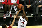 D.J. Gay #23 of San Diego State shoots the ball against Chris Kupets #2 of Utah on February 8, 2011 at Cox Arena in San Diego, California. SDSU beat Utah 85-58.