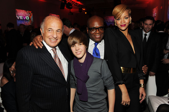 (L-R) Chairman & CEO of UMG Doug Morris, singer Justin Bieber, Chairman and CEO of Island Def Jam Music Group L.A. Reid and singer Rihanna attend the launch of VEVO, the world's premiere destination for premium music video and entertainmentat Skylight Studio on December 8, 2009 in New York City.