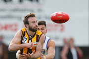 Lewis Pierce of Sandringham tackles Sam Iles of Box Hill during the VFL Preliminary Final match between Box Hill Hawks and Sandringham at North Port Oval on September 19, 2015 in Melbourne, Australia.