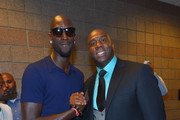 """NBA player Kevin Garnett (L) and NBA Hall of Fame member and Los Angeles Dodgers part owner Earvin """"Magic"""" Johnson arrives at the MGM Grand Garden Arena for the Floyd Mayweather Jr. vs. Canelo Alvarez boxing match on September 14, 2013 in Las Vegas, Nevada."""