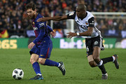 Geoffrey Kondogbia (R) of Valencia competes for the ball with Lionel Messi of Barcelona during the Copa del Rey semi-final second leg match between Valencia and Barcelona on February 8, 2018 in Valencia, Spain.