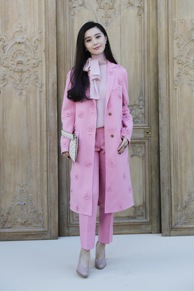 Fan Bingbing looked sweet in a pink Valentino coat with tonal flower appliques, which she teamed with a matching blouse and pants, during the label's Spring 2017 show.