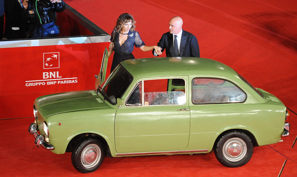 Lancia On The Red Carpet At The Rome Film Fest [land vehicle,vehicle,car,classic car,coup\u00e9,subcompact car,city car,family car,sedan,classic,valeria golino,luca znigarelli,lancia on the red carpet at the rome film fest,italy,rome,la kryptonite kella borsa premiere during the 6th rome film festival at auditorium parco della musica]